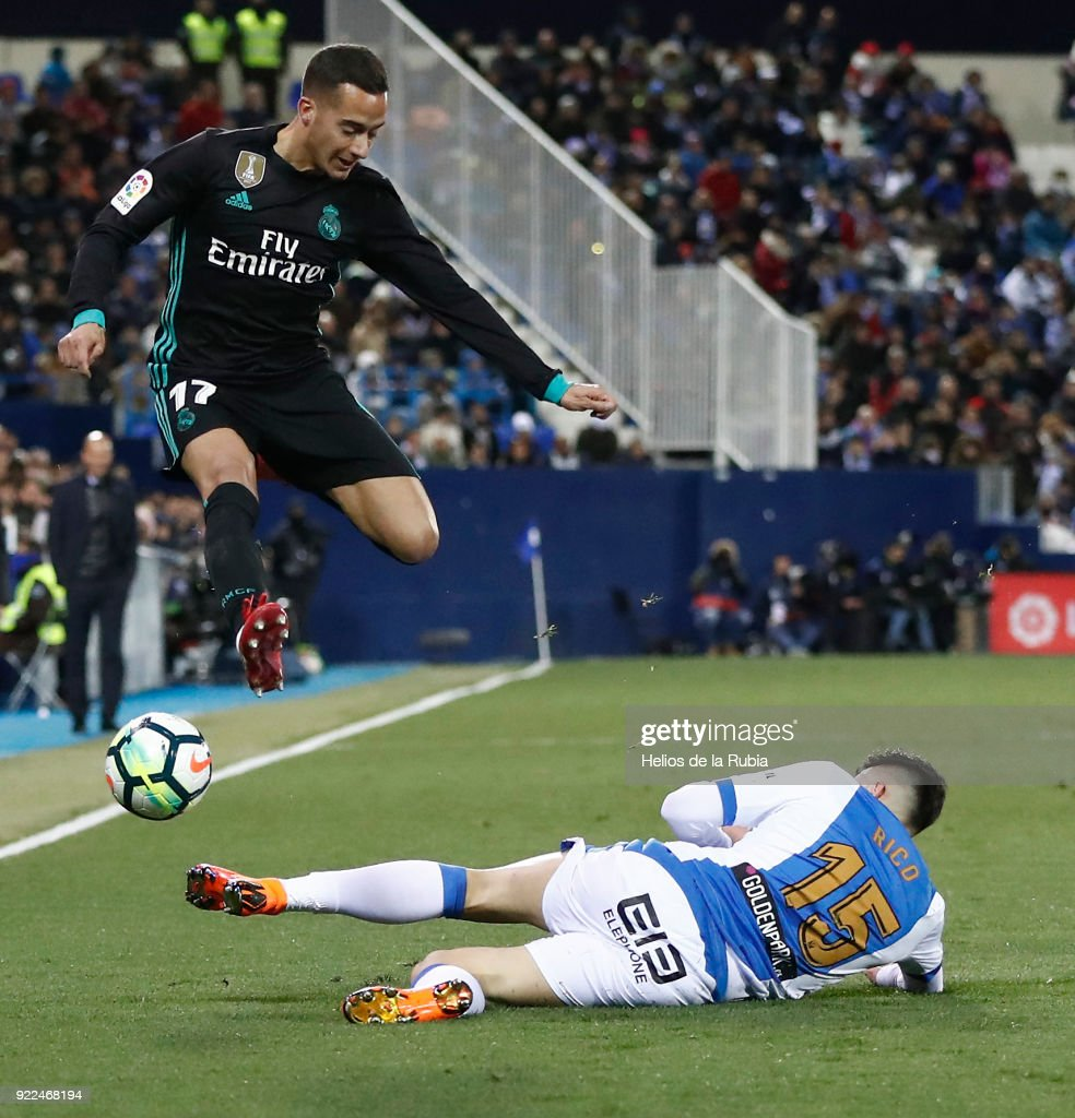 Lucas Vazquez of Real Madrid and Diego Rico of Leganes compete for the ball during the La Liga match between Leganes and Real Madrid at Municipal de Butarque on February 21, 2018 in Madrid, Spain.