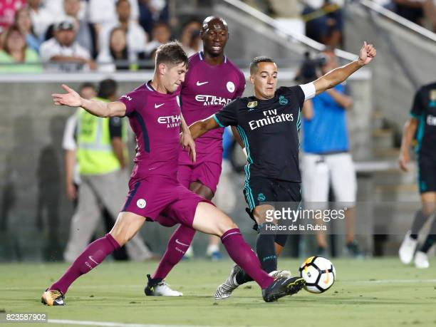 Lucas Vazquez of Real Madrid and John Stones of Manchester City compete for the ball during the International Champions Cup 2017 match between...