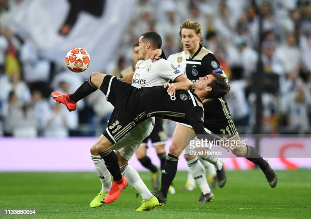 Lucas Vazquez of Real Madrid and Nicolas Tagliafico of Ajax tangle during the UEFA Champions League Round of 16 Second Leg match between Real Madrid...