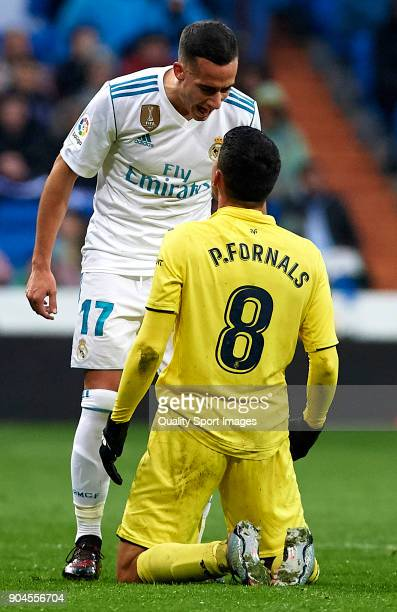 Lucas Vazquez of Real Madrid argues with Pablo Fornals of Villarreal during the La Liga match between Real Madrid and Villarreal at Estadio Santiago...