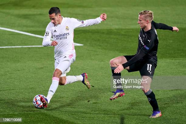 Lucas Vazquez of Real Madrid battle for the ball with Oscar Wendt of Borussia Moenchengladbach during the UEFA Champions League Group B stage match...