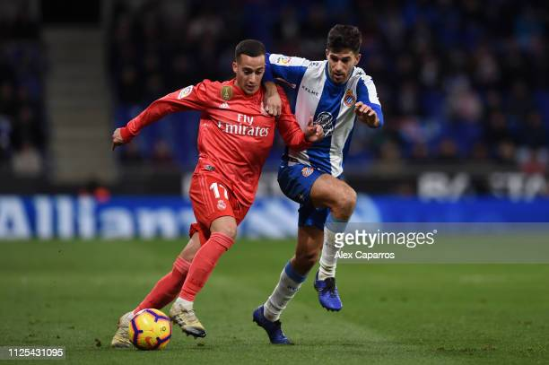 Lucas Vazquez of Real Madrid battles for possession with Didac Vila Rossello of RCD Espanyol during the La Liga match between RCD Espanyol and Real...