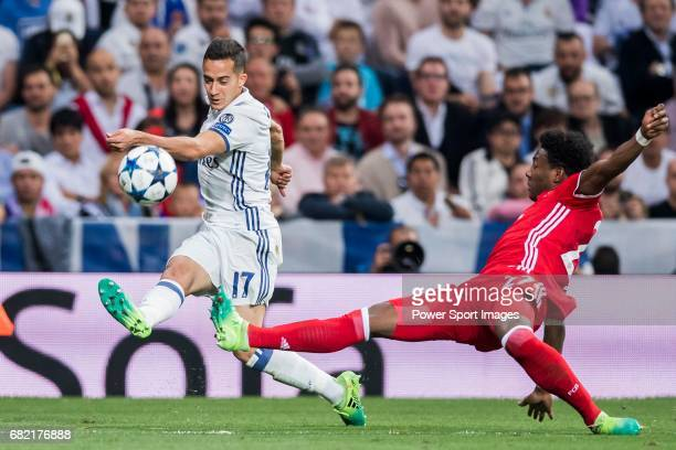 Lucas Vazquez of Real Madrid battles for the ball with David Alaba of FC Bayern Munich during their 201617 UEFA Champions League Quarterfinals second...