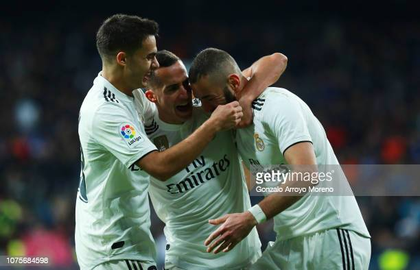 Lucas Vazquez of Real Madrid celebrates after scoring his team's second goal with Karim Benzema and Sergio Reguilon during the La Liga match between...