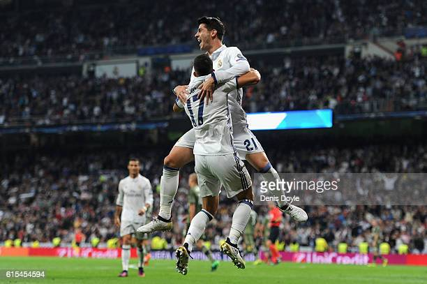 Lucas Vazquez of Real Madrid celebrates scoring his team's fourth goal with his team mate Alvaro Morata during the UEFA Champions League Group F...