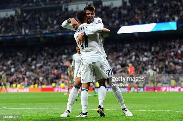 Lucas Vazquez of Real Madrid celebrates scoring his team's fourth goal with his team mate Alvaro Morata during the UEFA Champions League Group F...