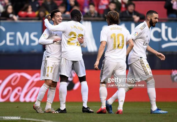 Lucas Vazquez of Real Madrid celebrates with Ferland Mendy and Luka Modric after scoring his team's third goal during the La Liga match between CA...