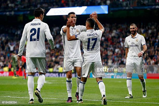 Lucas Vazquez of Real Madrid celebrates with his teammate Cristiano Ronaldo after scoring his team's fourth goal during the UEFA Champions League...