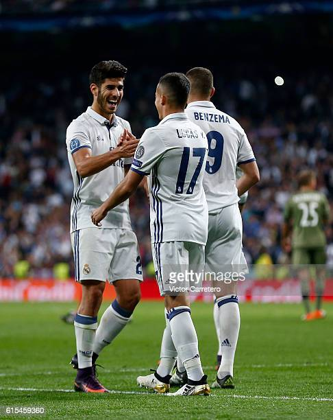 Lucas Vazquez of Real Madrid celebrates with his teammate Marco Asensio after scoring his team's fourth goal during the UEFA Champions League Group F...