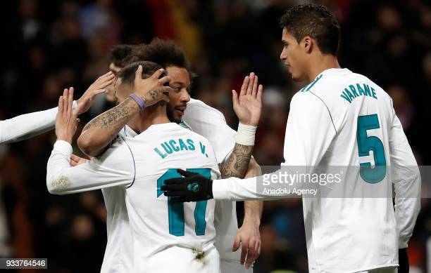 Lucas Vazquez of Real Madrid celebrates with Marcelo and Varane after scoring a goal during the La Liga soccer match between Real Madrid and Girona...