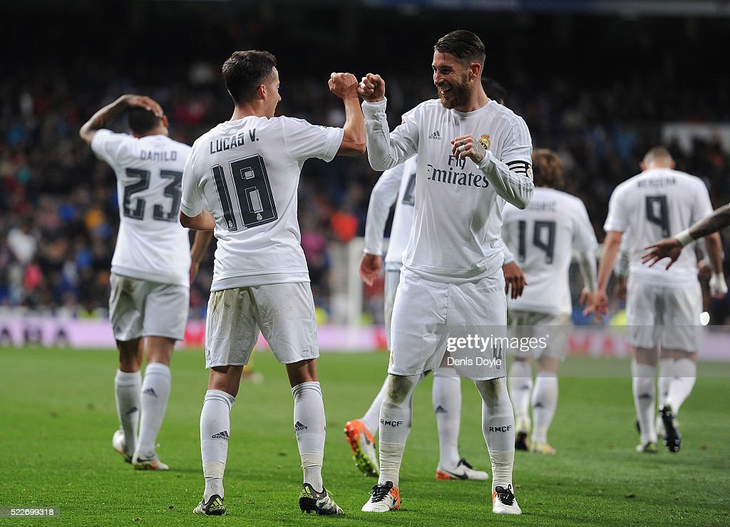Lucas Vazquez of Real Madrid celebrates with Sergio Ramos after scoring Real's 2nd goal during the La Liga match between Real Madrid and Villarreal at Estadio Santiago Bernabeu on April 20, 2016 in Madrid, Spain.