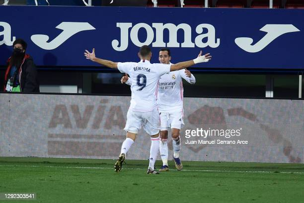 Lucas Vazquez of Real Madrid celebrates with teammate Karim Benzema after scoring their team's third goal during the La Liga Santander match between...