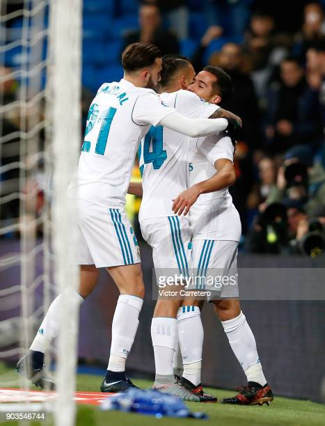 Lucas Vazquez of Real Madrid celebrates with teammates Daniel Ceballos and Borja Mayoral after scoring the opening goal during the Copa del Rey round...
