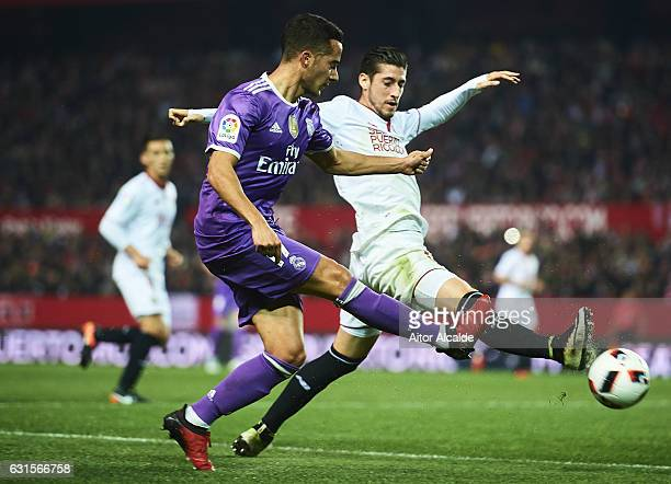 Lucas Vazquez of Real Madrid CF being followed by Sergio Escudero of Sevilla FC during the Copa del Rey Round of 16 Second Leg match between Sevilla...