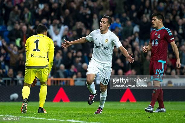 Lucas Vazquez of Real Madrid CF celebrates scoring their third goal against goalkeeper Geronimo Rulli of Real Sociedad de Futbol and his teammate...