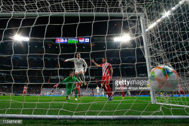 Lucas Vazquez of Real Madrid CF clashes with goalkeeper Gorka Iraizoz as Karim Benzema scores their fourth goal during the Copa del Rey Quarter Final...