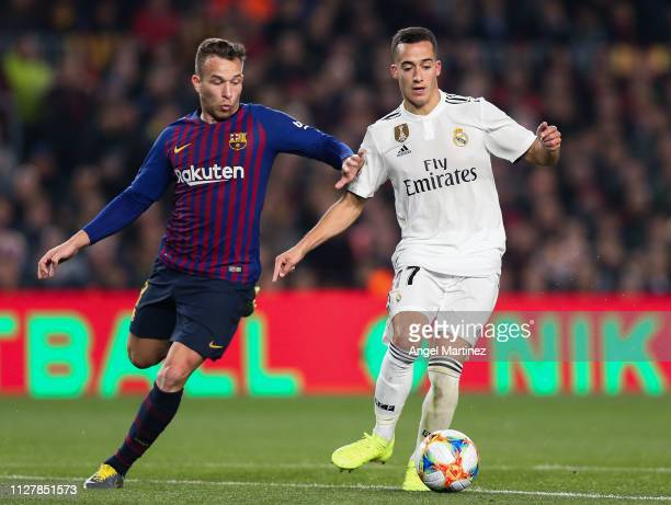 Lucas Vazquez of Real Madrid CF competes for the ball with Arthur Melo of FC Barcelona during the Copa del Semi Final first leg match between...