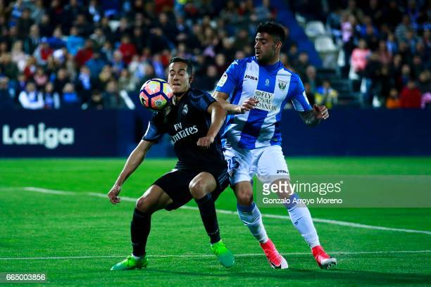Lucas Vazquez of Real Madrid CF competes for the ball with Diego Rico of Deportivo Leganes during the La Liga match between CD Leganes and Real...