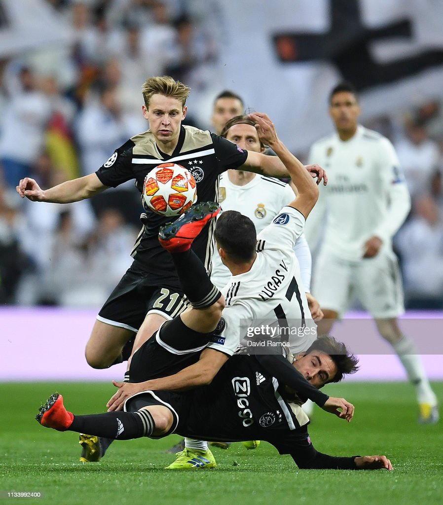 Uefa Champions League Round Of: Lucas Vazquez Of Real Madrid CF Competes For The Ball With