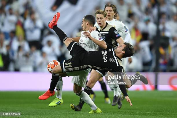 Lucas Vazquez of Real Madrid CF competes for the ball with Frenkie De Jong and Nicolas Tagliafico of Ajax during the UEFA Champions League Round of...