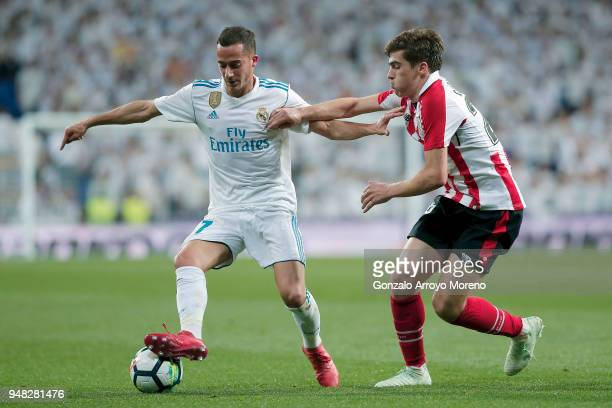 Lucas Vazquez of Real Madrid CF competes for the ball with Inigo Cordoba of Athletic Club during the La Liga match between Real Madrid CF and...