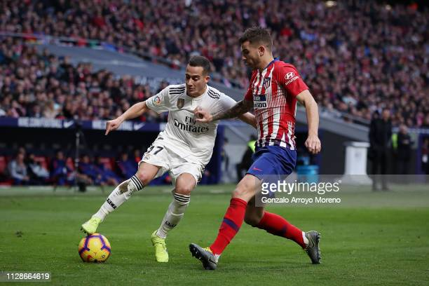 Lucas Vazquez of Real Madrid CF competes for the ball with Lucas Hernandez of Atletico de Madrid during the La Liga match between Club Atletico de...