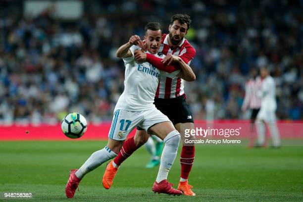 Lucas Vazquez of Real Madrid CF competes for the ball with Mikel Balenziaga of Athletic Club during the La Liga match between Real Madrid CF and...