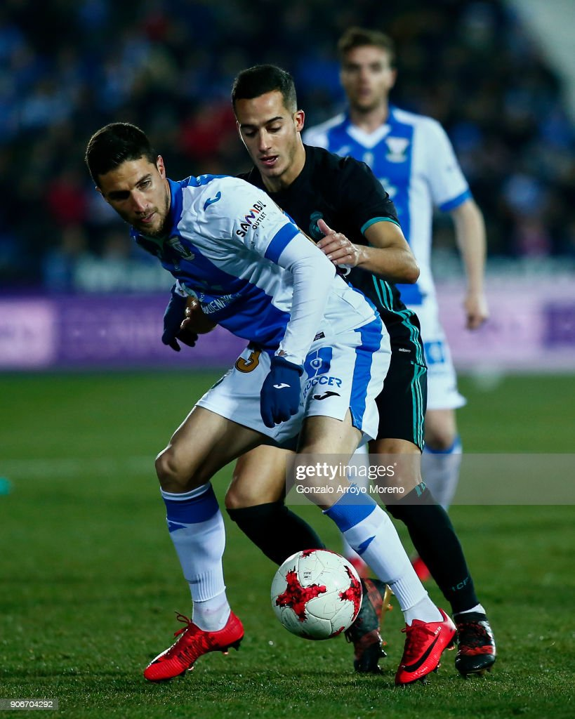 Lucas Vazquez (R) of Real Madrid CF competes for the ball with Omar Ramos (L) of Deportivo Leganes during the Copa del Rey quarter final first leg match between Real Madrid CF and Club Deportivo Leganes at Estadio Municipal de Butarque on January 18, 2018 in Leganes, Spain.