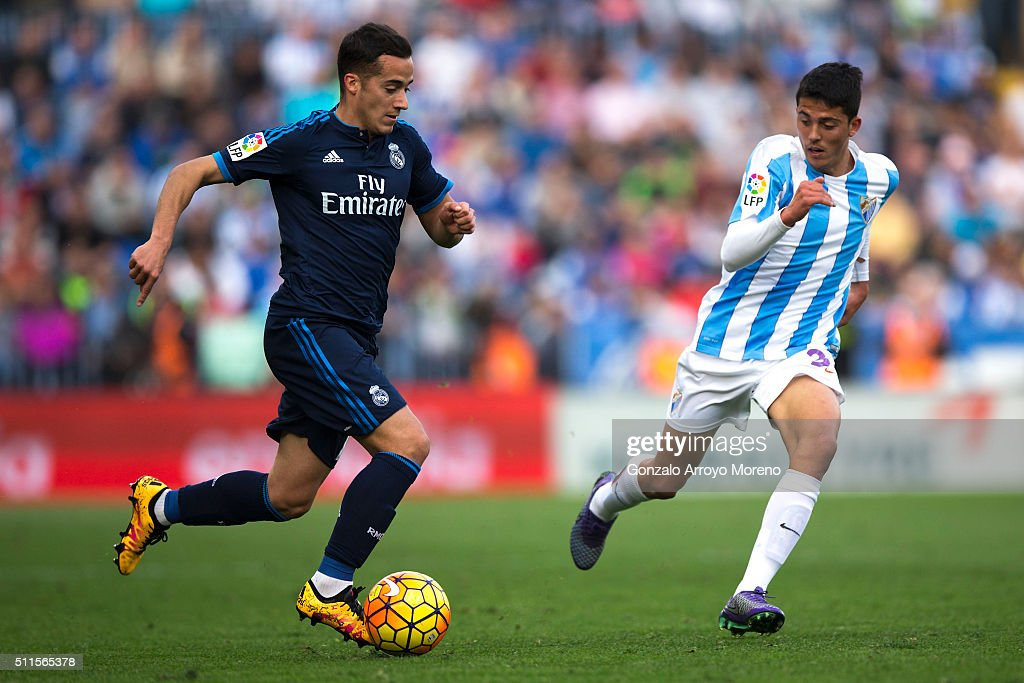Lucas Vazquez (L) of Real Madrid CF competes for the ball with Pablo Fornals (R) of Malaga CF during the La Liga match between Malaga CF and Real Madrid CF at La Rosaleda Stadium on February 21, 2016 in Malaga, Spain.