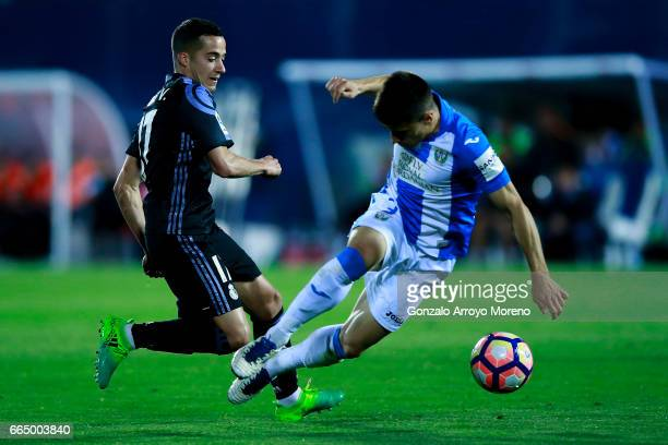 Lucas Vazquez of Real Madrid CF competes for the ball with Unai Bustinza of Deportivo Leganes during the La Liga match between CD Leganes and Real...