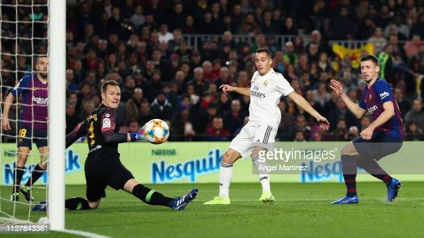 Lucas Vazquez of Real Madrid CF scores his team's first goal past Marc-Andre ter Stegen and Clement Lenglet of FC Barcelona during the Copa del Semi...