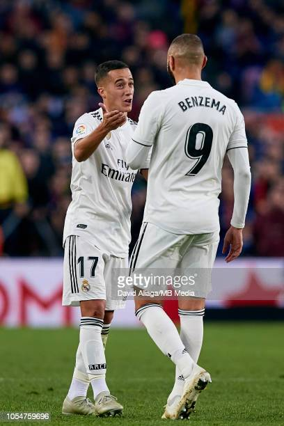 Lucas Vazquez of Real Madrid CF talks with his teammate Karim Benzema during the La Liga match between FC Barcelona and Real Madrid CF at Camp Nou on...