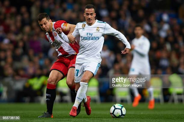 Lucas Vazquez of Real Madrid competes for the ball with Alex Granell of Girona during the La Liga match between Real Madrid and Girona at Estadio...