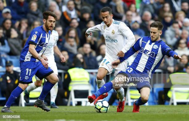 Lucas Vazquez of Real Madrid competes for the ball with Alvaro Medran of Deportivo Alaves during the La Liga match between Real Madrid and Deportivo...