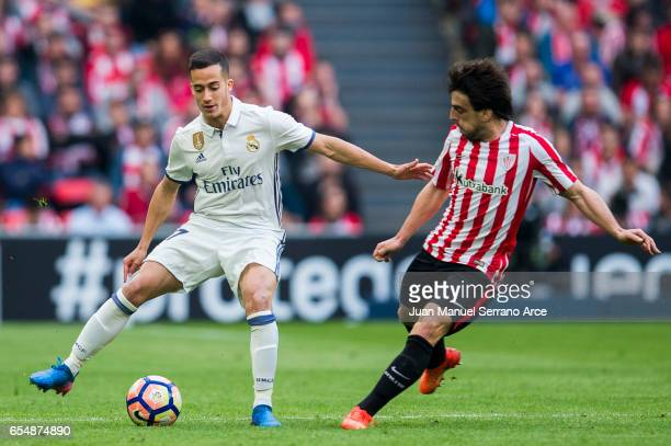 Lucas Vazquez of Real Madrid competes for the ball with Benat Etxebarria of Athletic Club during the La Liga match between Athletic Club Bilbao and...