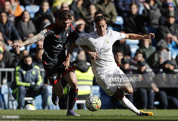 Lucas Vazquez of Real Madrid competes for the ball with Carles Planas of Celta Vigo during the La Liga match between Real Madrid CF and Celta Vigo at...