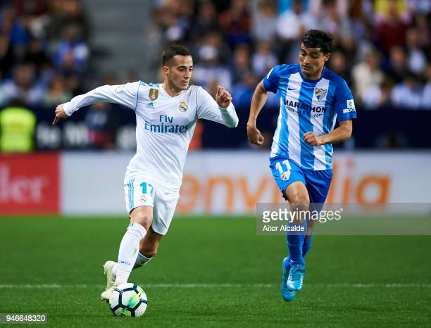 Lucas Vazquez of Real Madrid competes for the ball with Chory Castro of Malaga during the La Liga match between Malaga CF and Real Madrid CF at...
