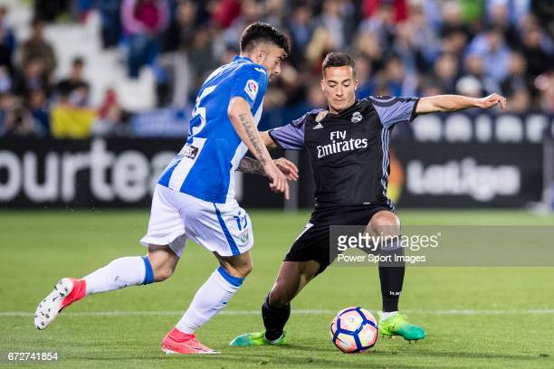 Lucas Vazquez of Real Madrid competes for the ball with Diego Rico of Deportivo Leganes during their La Liga match between Deportivo Leganes and Real...