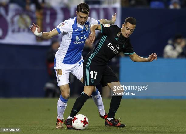 Lucas Vazquez of Real Madrid competes for the ball with Jose Naranjo of Leganes during the Spanish Copa del Rey Quarter Final First Leg match between...