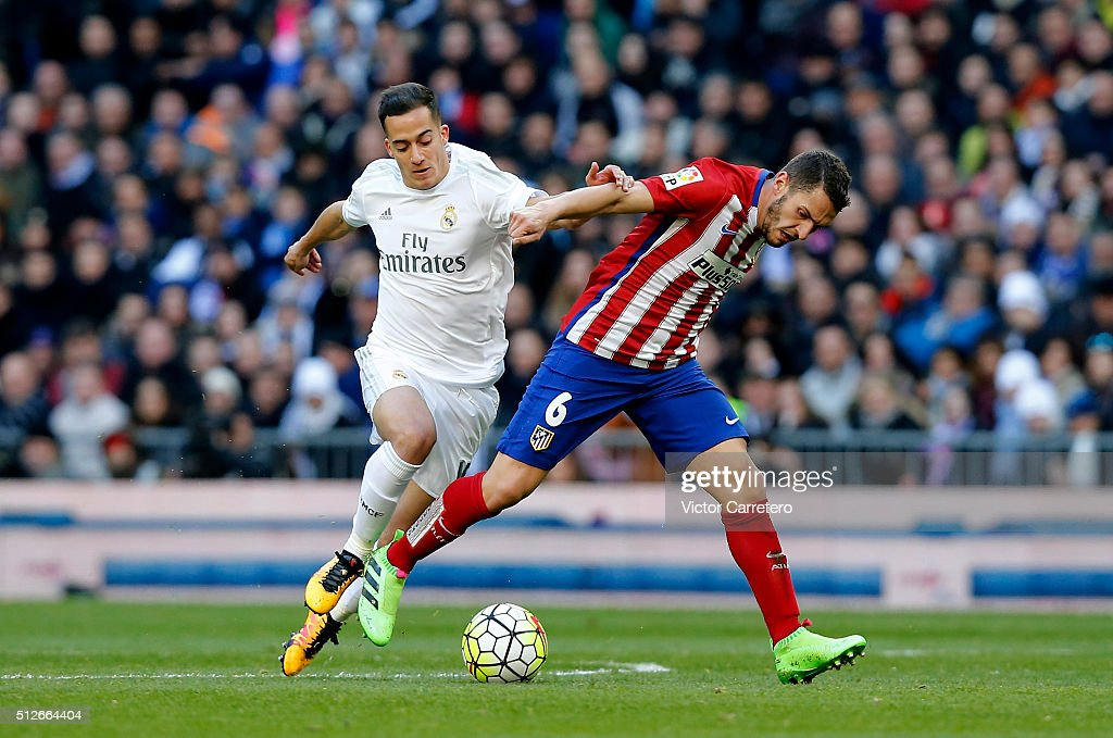 Lucas Vazquez of Real Madrid competes for the ball with Koke of Atletico de Madrid during the La Liga match between Real Madrid CF and Club Atletico de Madrid at Estadio Santiago Bernabeu on February 27, 2016 in Madrid, Spain.