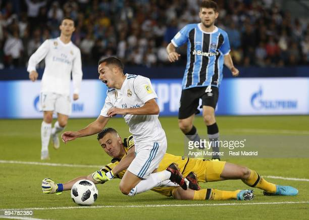 Lucas Vazquez of Real Madrid competes for the ball with Marcelo Grohe of Gremio during the FIFA Club World Cup UAE 2017 Final match between Real...