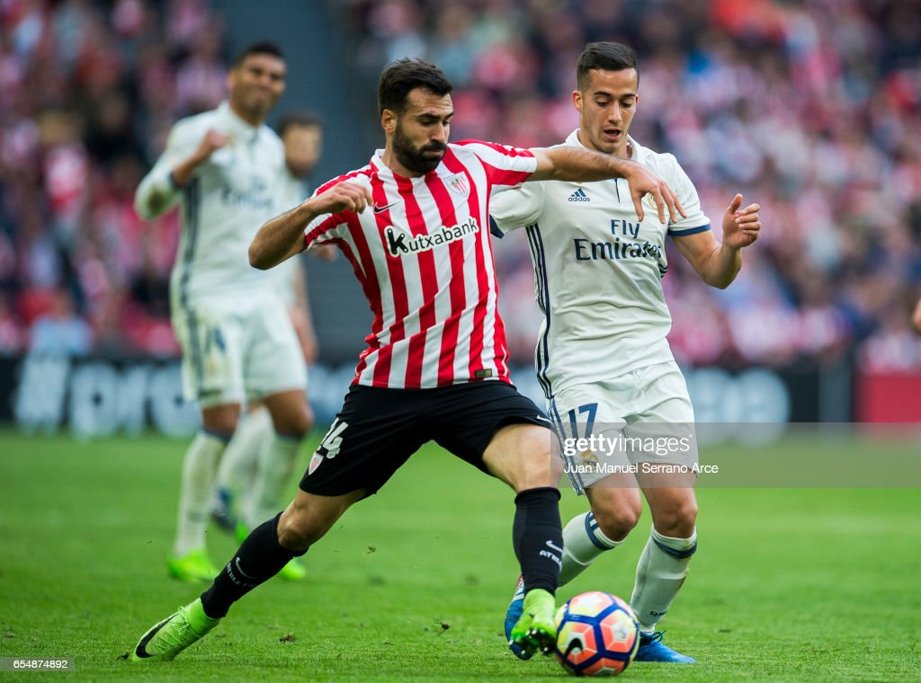Lucas Vazquez of Real Madrid competes for the ball with Mikel Balenziaga of Athletic Club during the La Liga match between Athletic Club Bilbao and Real Madrid at San Mames Stadium on on March 18, 2017 in Bilbao, Spain.