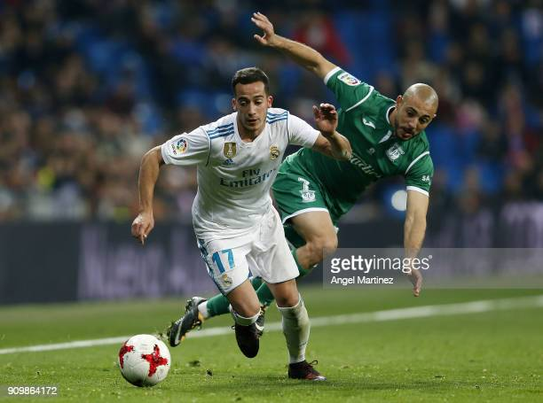 Lucas Vazquez of Real Madrid competes for the ball with Nordin Amrabat of Leganes during the Spanish Copa del Rey Quarter Final Second Leg match...