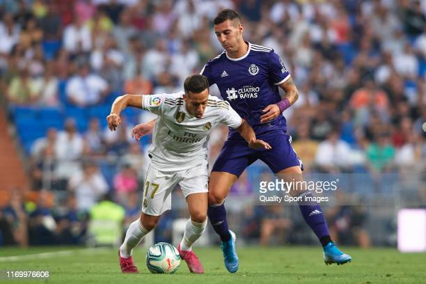 Lucas Vazquez of Real Madrid competes for the ball with Sergi Guardiola of Real Valladolid during the Liga match between Real Madrid CF and Real...