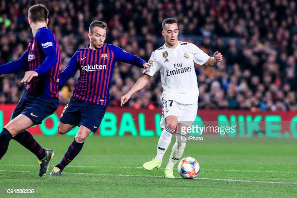 Lucas Vazquez of Real Madrid defended by 08 Arthur Melo of FC Barcelona during the semi-final first leg of Spanish King Cup / Copa del Rey football...