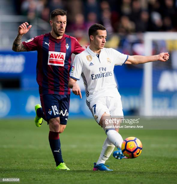 Lucas Vazquez of Real Madrid duels for the ball with Antonio Luna of SD Eibar during the La Liga match between SD Eibar and Real Madrid at Ipurua...