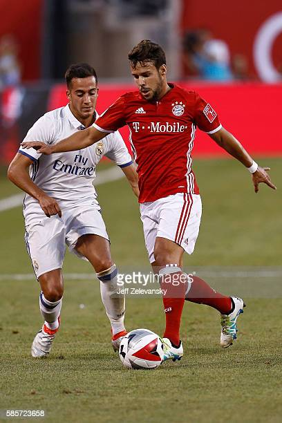 Lucas Vazquez of Real Madrid fights for the ball with Juan Bernat of Bayern Munich during their International Champions Cup match at MetLife Stadium...