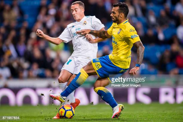 Lucas Vazquez of Real Madrid fights for the ball with Michel Macedo Rocha Machado of UD Las Palmas during the La Liga 201718 match between Real...