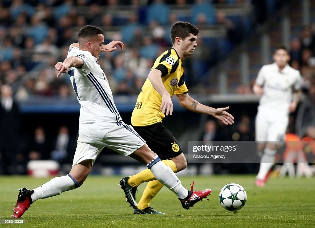 Lucas Vazquez (L) of Real Madrid in action against Christian Pulisic of Borussia Dortmund during the UEFA Champions League Group F football match between Real Madrid and Borussia Dortmund at Santiago Bernabeu Stadium in Madrid, Spain on December 7, 2016.