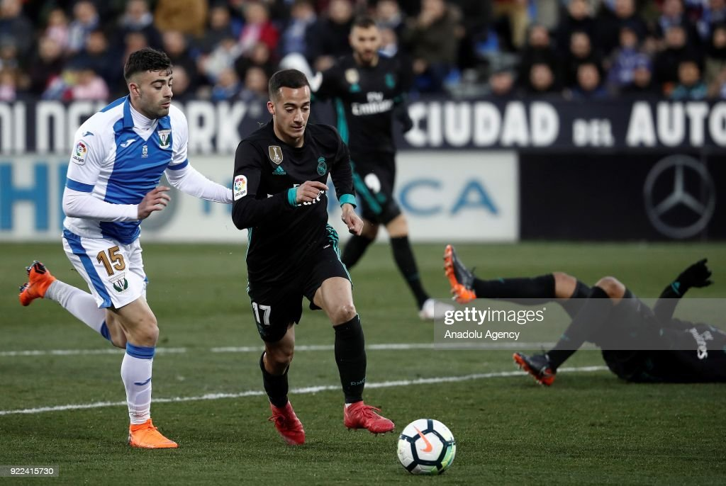 Lucas Vazquez of Real Madrid in action against Diego Rico of Leganes during the La Liga football match between Leganes and Real Madrid at the Estadio Municipal Butarque in Madrid, Spain on February 21, 2018.